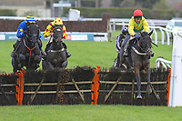 Sizing at Midnight (r) ridden by Tom Scudamore and trained by Colin Tizzard jump the last second time around in The John And Jean Taylor's Diamond Anniversary Handicap Hurdle during Horse Racing at Plumpton Racecourse on 4th November 2019