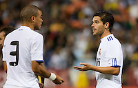 Pepe (left) talks with Fernando Gago (right). Real Madrid defeated Club America 3-2 at Candlestick Park in San Francisco, California on August 4th, 2010.