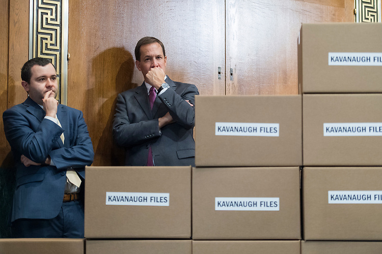 UNITED STATES - AUGUST 02: Aides attend a news conference with Republican members of the Senate Judiciary Committee Chairman in Dirksen Building on August 2, 2018, with boxes representing roughly 1 million pages of documents to be submitted to the committee on Supreme Court nominee Brett Kavanaugh. (Photo By Tom Williams/CQ Roll Call)