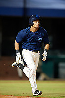 Mobile BayBears center fielder Michael Hermosillo (21) runs to first base during a game against the Pensacola Blue Wahoos on April 25, 2017 at Hank Aaron Stadium in Mobile, Alabama.  Mobile defeated Pensacola 3-0.  (Mike Janes/Four Seam Images)