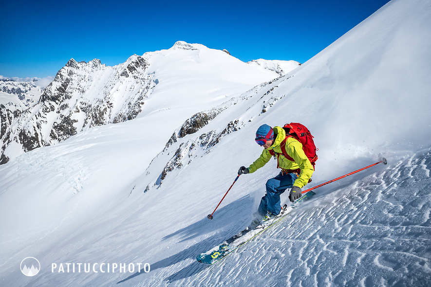 Skiing off the Gwächtenhorn while ski touring on the Berner Haute Route, Switzerland.