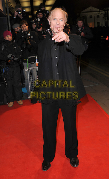 "ED HARRIS .attending ""The Way Back"" UK film premiere, Curzon Mayfair cinema, London, England, UK,.8th December 2010 ..full length black coat  scarf jacket hand trousers suit finger pointing gesture .CAP/BEL.©Tom Belcher/Capital Pictures."