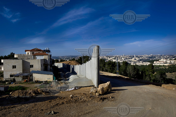 Part of the construction of the wall that separates Israel and Palestine, next to the new settlement of Har Gilo.