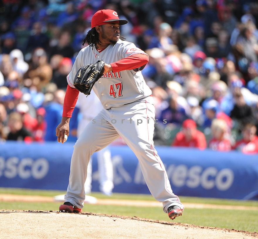 JOHNNY CUETO, of the Cincinnati Reds, in action during the Reds game against the Chicago Cubs on April 22, 2012, at Wrigley Field in Chicago, IL. The Reds beat the Cubs 4-3.