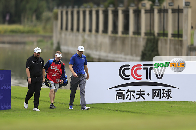 Shane Lowry (IRL) and Ross Fisher (ENG) walking onto the 4th green during the final round of the WGC-HSBC Champions, Sheshan International GC, Shanghai, China PR.  30/10/2016<br /> Picture: Golffile | Fran Caffrey<br /> <br /> <br /> All photo usage must carry mandatory copyright credit (&copy; Golffile | Fran Caffrey)