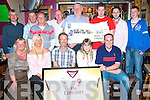 2282-2286.Prize winner: Ian moss (seated centre) was the lucky winner of a framed Arsenal shirt signed by all the team at a special evening in the Greyhound bar, Pembroke St., Tralee last Friday organised by Arsenal Tralee supporters club.They also held a charity draw and gave the EUR850 proceeds to the Palliative Care unit of Kerry General Hospital. Seated l-r: Tess & Sandra Breen, Ian Moss, Hanora & DJ Brosnan. Back l-r: Sean Lynch, Tom Cantillon, James Breen, Tony Monaghan, Tom Crowley, Padraig Scanlon, Derek Holden and Shane Lynch.