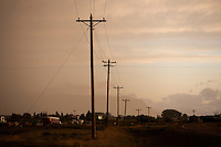 Powerlines stand along State Route 200 outside Fort Shaw, Montana, USA.