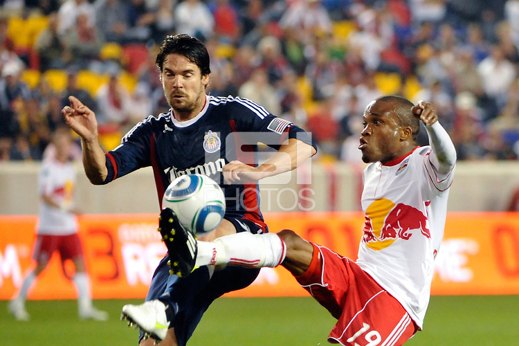 Heath Pearce (3) of CD Chivas USA and Dane Richards (19) of the New York Red Bulls look to play the ball. CD Chivas USA defeated the New York Red Bulls 3-2 during a Major League Soccer (MLS) match at Red Bull Arena in Harrison, NJ, on May 15, 2011.