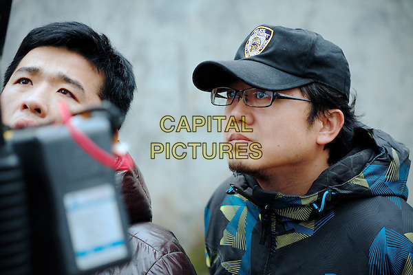 Yukun Xin (Director)<br /> on the set of The Coffin in the Mountain (2014) <br /> (Binguan)<br /> *Filmstill - Editorial Use Only*<br /> CAP/NFS<br /> Image supplied by Capital Pictures