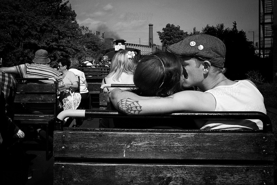 A trip on a steam train from the M-Shed in bristol to the Create centre a mile or so down the road takes all of 5 minutes. On the return journey this couple snatched a brief kiss. I had been waiting. I thought they might.