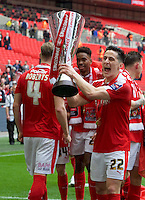George Williams of Barnsley with the trophy after winning the Johnstone's Paint Trophy Final match between Oxford United and Barnsley at Wembley Stadium, London, England on 3 April 2016. Photo by Alan  Stanford / PRiME Media Images.