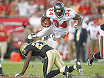 Tampa Bay Buccaneers running back Earnest Graham (34) goes airborne over New Orleans Saints free safety Malcolm Jenkins (27) to get a first down.  The Buccaneers defeated the Saints 26-20 in an NFL game, Sunday, Oct. 16, 2011 in Tampa, Fla. (AP Photo/Margaret Bowles)