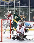 Drew MacKenzie (Vermont - 2) celebrates his tying goal. - The University of Massachusetts (Amherst) Minutemen defeated the University of Vermont Catamounts 3-2 in overtime on Saturday, January 7, 2012, at Fenway Park in Boston, Massachusetts.