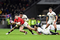 Steff Evans of Wales looks to offload the ball after being tackled. Natwest 6 Nations match between England and Wales on February 10, 2018 at Twickenham Stadium in London, England. Photo by: Patrick Khachfe / Onside Images