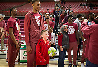 NWA Democrat-Gazette/CHARLIE KAIJO Arkansas Razorbacks players take pictures with fans during an NCAA selection show, Sunday, March 11, 2018 at Bud Walton Arena in Fayetteville. The Razorbacks will play Butler in Detroit on Friday