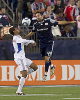 New England Revolution defender Ryan Cochrane (45) heads away a pass to San Jose Earthquakes forward Chris Wondolowski (8). In a Major League Soccer (MLS) match, the San Jose Earthquakes defeated the New England Revolution, 2-1, at Gillette Stadium on October 8, 2011.