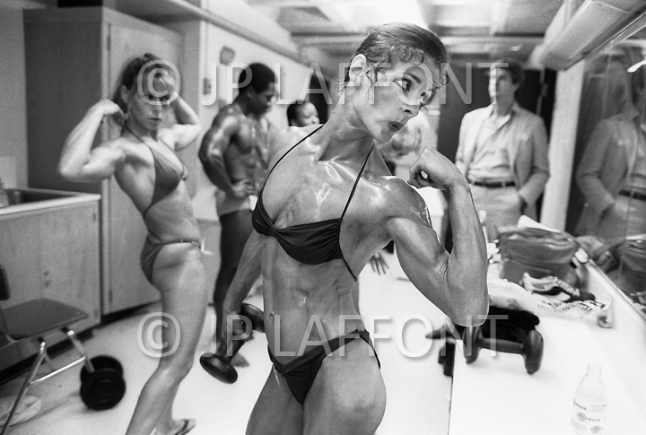 New York City, NY. June 20th, 1981. <br /> Valerie Mayers in front of mirror showing her biceps during the Ms. Empire State Competition.