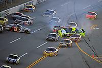 Nov. 1, 2009; Talladega, AL, USA; NASCAR Sprint Cup Series drivers Scott Speed (82), Mark Martin (5) and Martin Truex Jr (1) crash in a multi car accident during the Amp Energy 500 at the Talladega Superspeedway. Mandatory Credit: Mark J. Rebilas-