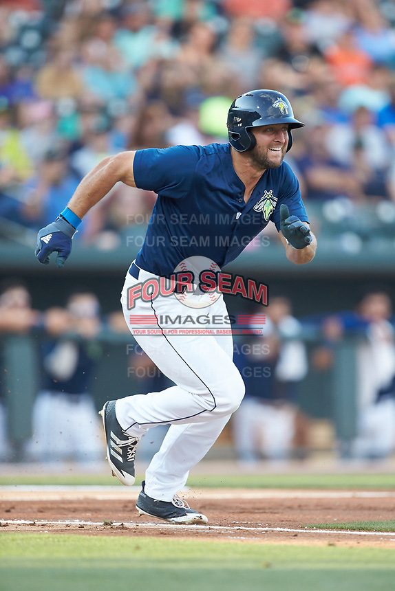 Tim Tebow (15) of the Columbia Fireflies hustles down the first base line against the Charleston RiverDogs at Spirit Communications Park on June 9, 2017 in Columbia, South Carolina.  The Fireflies defeated the RiverDogs 3-1.  (Brian Westerholt/Four Seam Images)