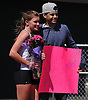 Kerri Goldfuss and Christian Azcona of Clarke High School pose for pictures after Goldfuss during the Cougar Invitational held at Bellmore JFK High School on Saturday, Apr. 16, 2016. Moments after Goldfuss competed in the girls 3,000 meter run, Azcona surprised her with flowers and a cardboard sign which he used to ask her to Clarke's prom.