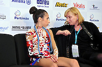 "Rebecca Sereda of USA (junior) talks with her coach at ""kiss & cry"" after performing in rope Event Final at 2010 World Cup at Portimao, Portugal on March 13, 2010.  (Photo by Tom Theobald)."