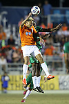 20 September 2014: Carolina's Leo Osaki (4) and New York's Joseph Nane (CMR) (behind). The Carolina RailHawks played the New York Cosmos at WakeMed Stadium in Cary, North Carolina in a 2014 North American Soccer League Fall Season match. Carolina won the game 5-4.