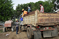 Battambang - Cambodia - June 2020<br /> -  early morning life around the river.<br /> workers leaving construction site.