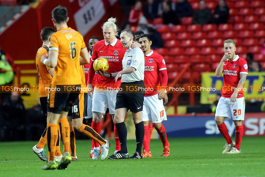 Charlton's Simon Makienok puts his arm around referee, Keith Hill, after colliding with him in the first half during Charlton Athletic vs Wolverhampton Wanderers, Sky Bet Championship Football at The Valley, London, England on 28/12/2015