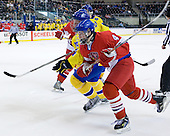 Gabriel Landeskog (Sweden - 14), Oldrich Horak (Czech Republic - 4) - Sweden defeated the Czech Republic 4-2 at the Urban Plains Center in Fargo, North Dakota, on Saturday, April 18, 2009, in their final match of the 2009 World Under 18 Championship.