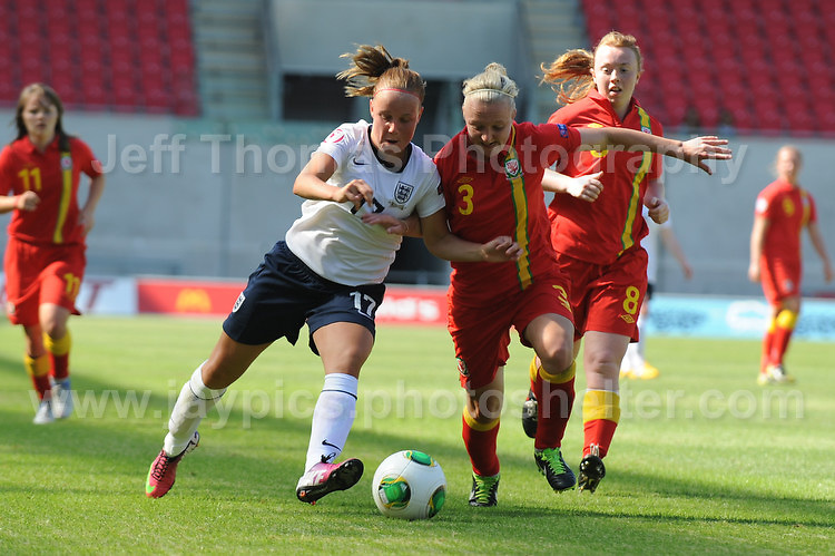 Bethany Mead of England battles with Lauren Elyse Hancock of Wales during the UEFA Womens U19 Championships at Parc y Scarlets, Monday 19th August 2013. All images are the copyright of Jeff Thomas Photography-www.jaypics.photoshelter.com-07837 386244-Any use of images must be authorised by the copyright owner.