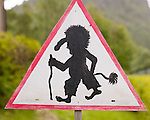 A road sign indicating yield for trolls.
