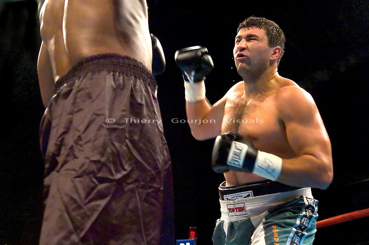 Timor Ibragimov (green trunk)  and Ronald Lee Bellamy during their 12 rounds Heavyweight fight at Madison Square Garden in NYC on 04.15.04. Ibragimov won by KO in the 3rd round