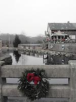 A Christmas wreath hangs near Tavern by the Sea in Wickford Village Rhode Island.