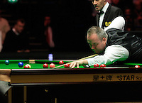 John Higgins watches the red ball as it rolls into the pocket during the Dafabet Masters Q/F 4 match between John Higgins and Stuart Bingham at Alexandra Palace, London, England on 15 January 2016. Photo by Liam Smith / PRiME Media Images