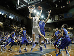SIOUX FALLS, SD - NOVEMBER 30:  Connor Devine #30 from South Dakota State University gets a rebound in front of Eric Moeller #42 from Florida Gulf Coast in the first half of their game Sunday afternoon at the Sanford Pentagon in Sioux Falls. (Photo by Dave Eggen/inertia)