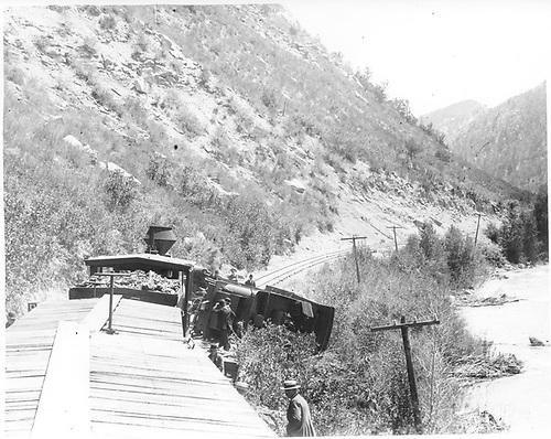 View from a boxcar top of an accident in which the lead engine of a double-headed freight has overturned and blocked the track two miles south of Durango at MP 449.2.<br /> D&amp;RG  s. of Durango, CO  Taken by Ballough, Monte - prior to 1905