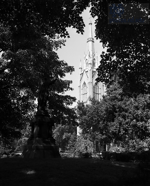 GPHR 45/0052:  Sacred Heart of Jesus Statue and the Basilica of the Sacred Heart exterior, c1950s..Image from the University of Notre Dame Archives.
