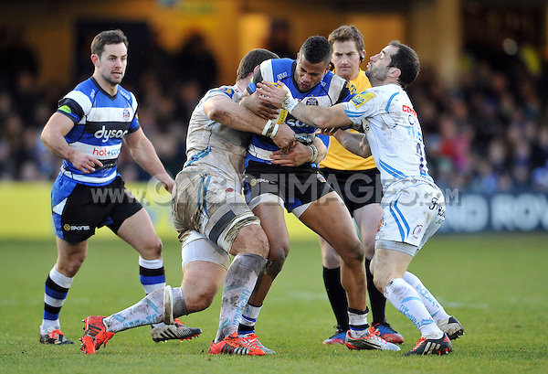 Anthony Watson of Bath Rugby takes on the Chiefs defence. Aviva Premiership match, between Bath Rugby and Exeter Chiefs on December 27, 2014 at the Recreation Ground in Bath, England. Photo by: Patrick Khachfe / Onside Images