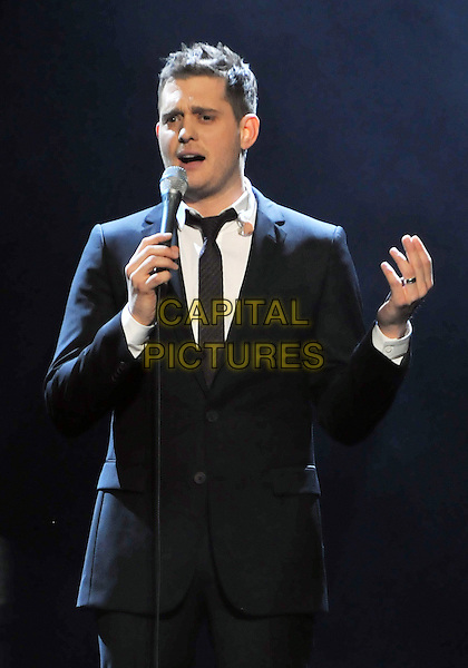 "MICHAEL BUBLE .performs in concert as a part of his ""Crazy Love Tour"" held at the CSU Convocation Center, Cleveland, Ohio, USA, 23rd March 2010..music gig live on stage  half length microphone black suit tie hand singing                            .CAP/ADM/DS.©Devin Simmons/AdMedia/Capital Pictures."