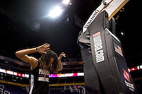 Jun. 10, 2013; Phoenix, AZ, USA: Phoenix Mercury center Brittney Griner reacts as she enters the court during a team practice at the US Airways Center. Mandatory Credit: Mark J. Rebilas-