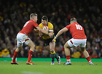 Australia's Bernard Foley is tackled by Wales' Gareth Anscombe<br /> <br /> Photographer Ian Cook/CameraSport<br /> <br /> Under Armour Series Autumn Internationals - Wales v Australia - Saturday 10th November 2018 - Principality Stadium - Cardiff<br /> <br /> World Copyright © 2018 CameraSport. All rights reserved. 43 Linden Ave. Countesthorpe. Leicester. England. LE8 5PG - Tel: +44 (0) 116 277 4147 - admin@camerasport.com - www.camerasport.com