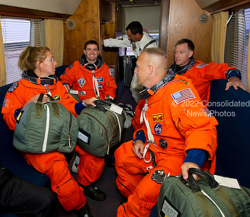 The STS-135 crew, clockwise: Sandra Magnus, mission specialist; Rex Walheim, mission specialist; Chris Ferguson, commander and Doug Hurley, pilot are seen in the Astrovan as they ride to launch pad 39A to board space shuttle Atlantis on Friday, July 8, 2011, at the Kennedy Space Center in Cape Canaveral, Florida.  The launch of Atlantis, STS-135, is the final flight of the shuttle program, a 12-day mission to the International Space Station.  .Mandatory Credit: Jerry Ross / NASA via CNP