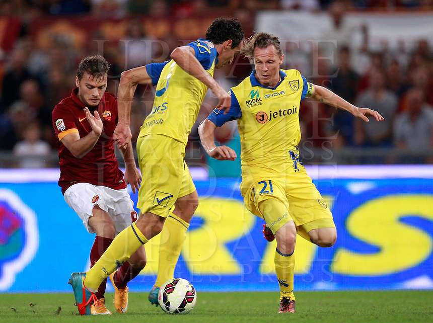 Calcio, Serie A: Roma vs ChievoVerona. Roma, stadio Olimpico, 18 ottobre 2014.<br /> Roma's Adem Ljajic, left, is challenged by Chievo Verona's Dario Dainelli, center, and Nicolas Frey, during the Italian Serie A football match between Roma and ChievoVerona at Rome's Olympic stadium, 18 October 2014.<br /> UPDATE IMAGES PRESS/Isabella Bonotto