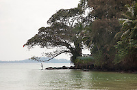 A lone fisherman on the edge of Taprobane Island, located on Sri Lanka's exotic south coast in Weligama Bay