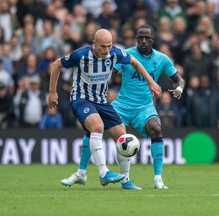 Brighton & Hove Albion's Aaron Mooy (left) under pressure from Tottenham Hotspur's Moussa Sissoko (right) <br /> <br /> Photographer David Horton/CameraSport<br /> <br /> The Premier League - Brighton and Hove Albion v Tottenham Hotspur - Saturday 5th October 2019 - The Amex Stadium - Brighton<br /> <br /> World Copyright © 2019 CameraSport. All rights reserved. 43 Linden Ave. Countesthorpe. Leicester. England. LE8 5PG - Tel: +44 (0) 116 277 4147 - admin@camerasport.com - www.camerasport.com