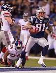 New England Patriots tight end Aaron Hernandez (81) celebrates a touchdown during the NFL Super Bowl XLVI football game against the New York Giants on Sunday, Feb. 5, 2012, in Indianapolis. The Giants won 21-17 (AP Photo/David Stluka)...