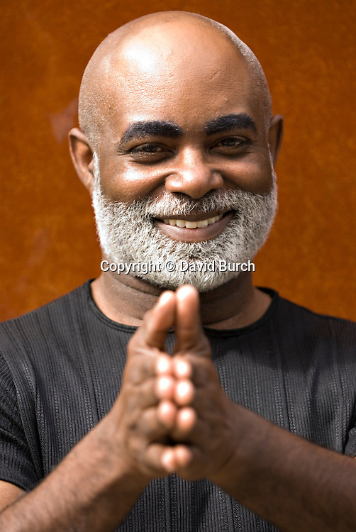 African American man, hands together, smiling