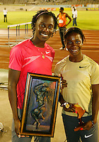 Kerron Stewart and Shelly-Ann Fraser pose for a photo at the Jamaica International Invitational Meet held at the National Stadium, Kingston Jamaica on Saturday, May 2nd. 2009. Photo by Errol Anderson, The Sporting Image.net