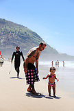 BRAZIL, Rio de Janiero, a father chases his daughter on Prainha Beach
