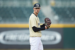Wake Forest Demon Deacons starting pitcher Carter Bach (18) looks to his catcher for the sign against the Charlotte 49ers at BB&T BallPark on March 13, 2018 in Charlotte, North Carolina.  The 49ers defeated the Demon Deacons 13-1.  (Brian Westerholt/Sports On Film)